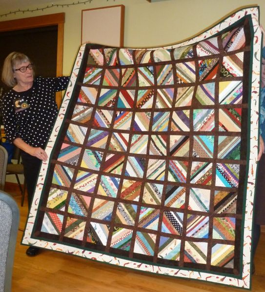 Rommie-Circle Spiral Strip Quilt