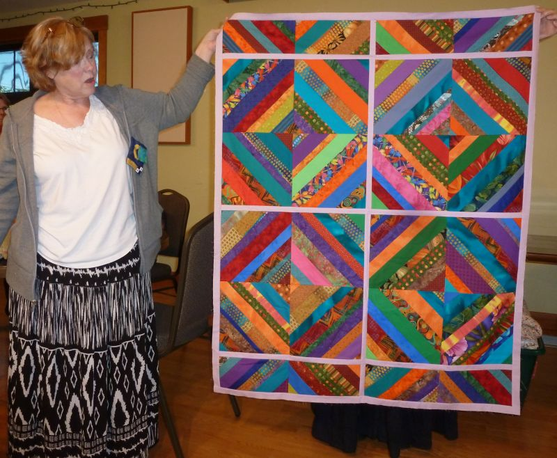 Sherry holds sample String Quilt