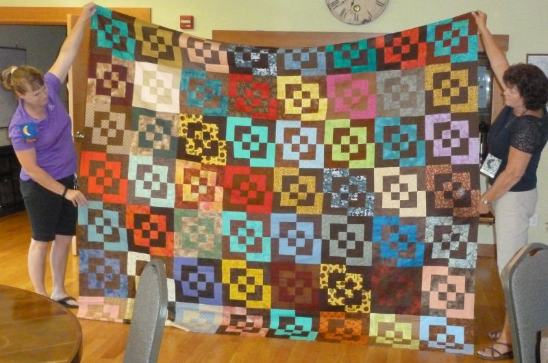 Dawn & Cindy Hold Raffle Quilt Top