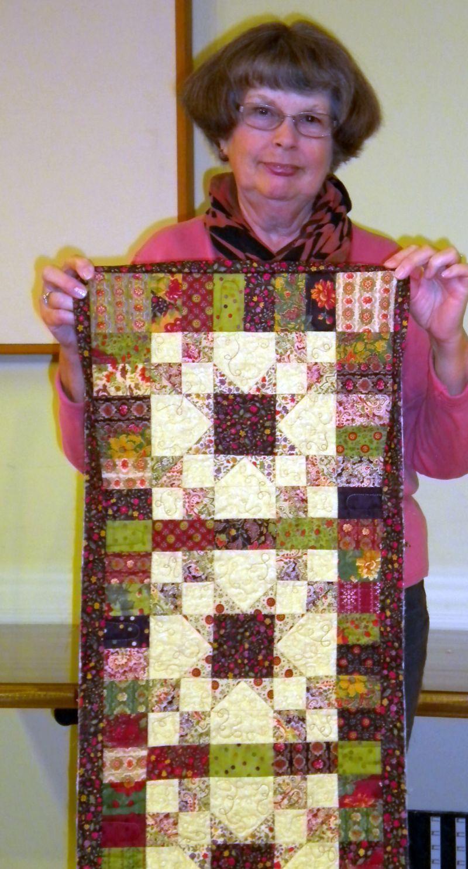 Linda C. Runner made from fabrics won at raffle