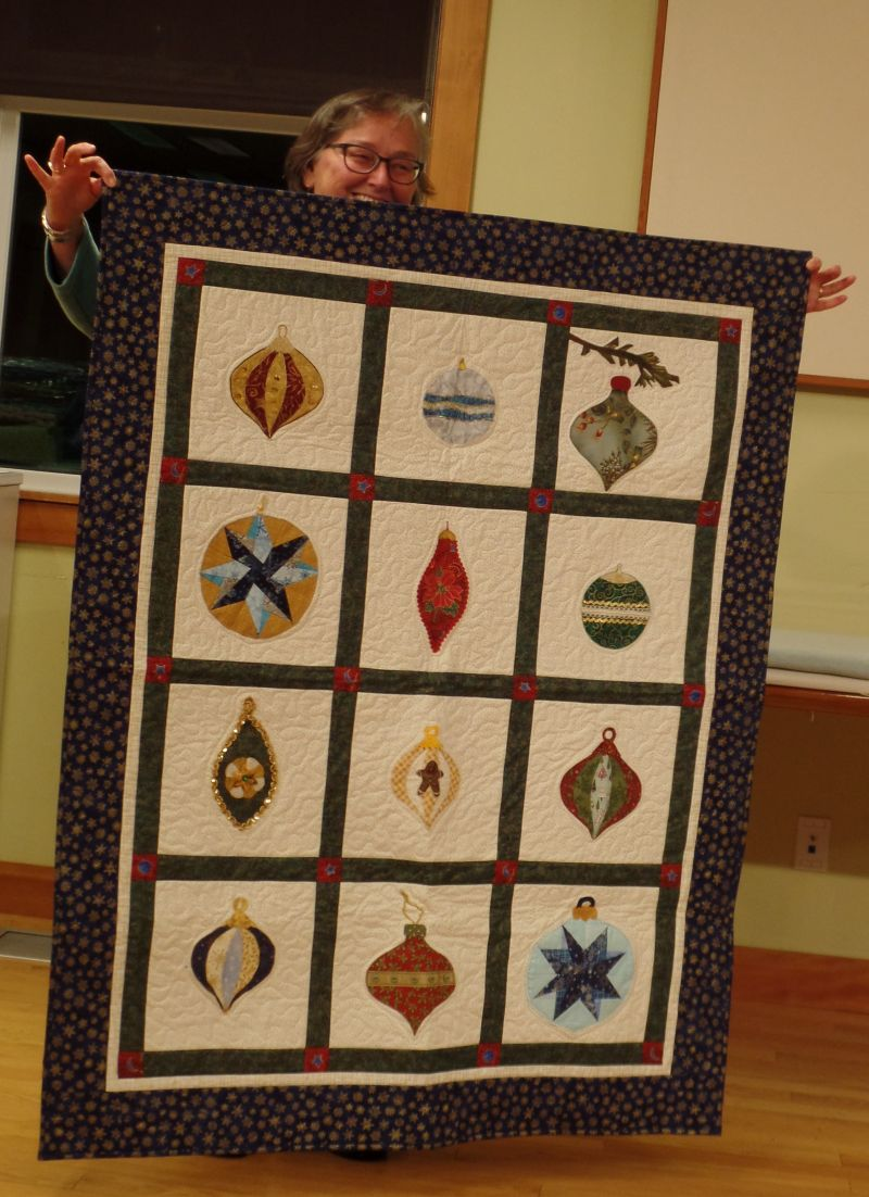 Val shared the quilt she made from Retreat Raffle blocks in 2014.