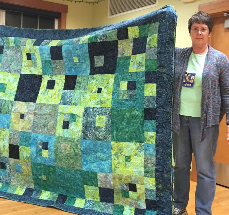Joan with commissioned quilt