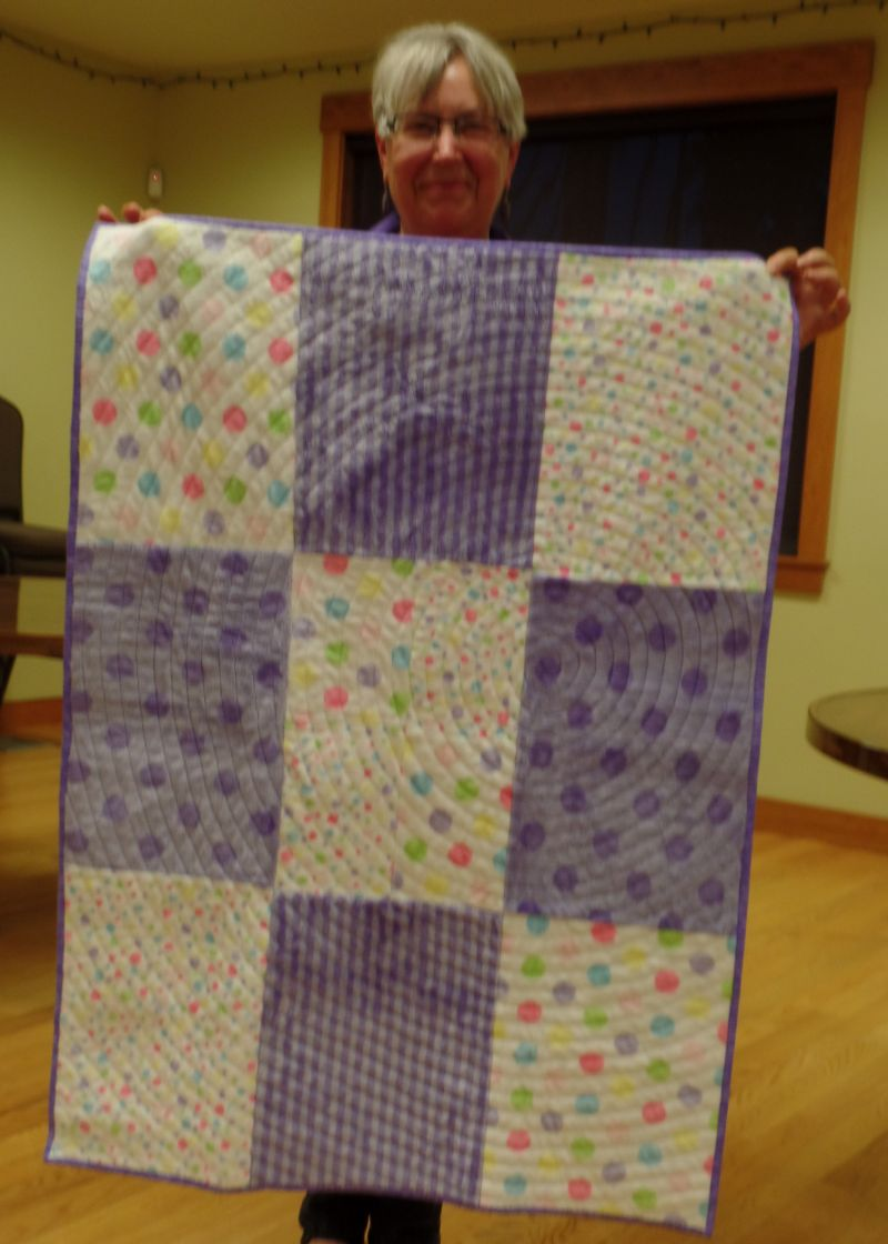 Lynn M. shows her quilt back using quilting technique from Tonya Alexander