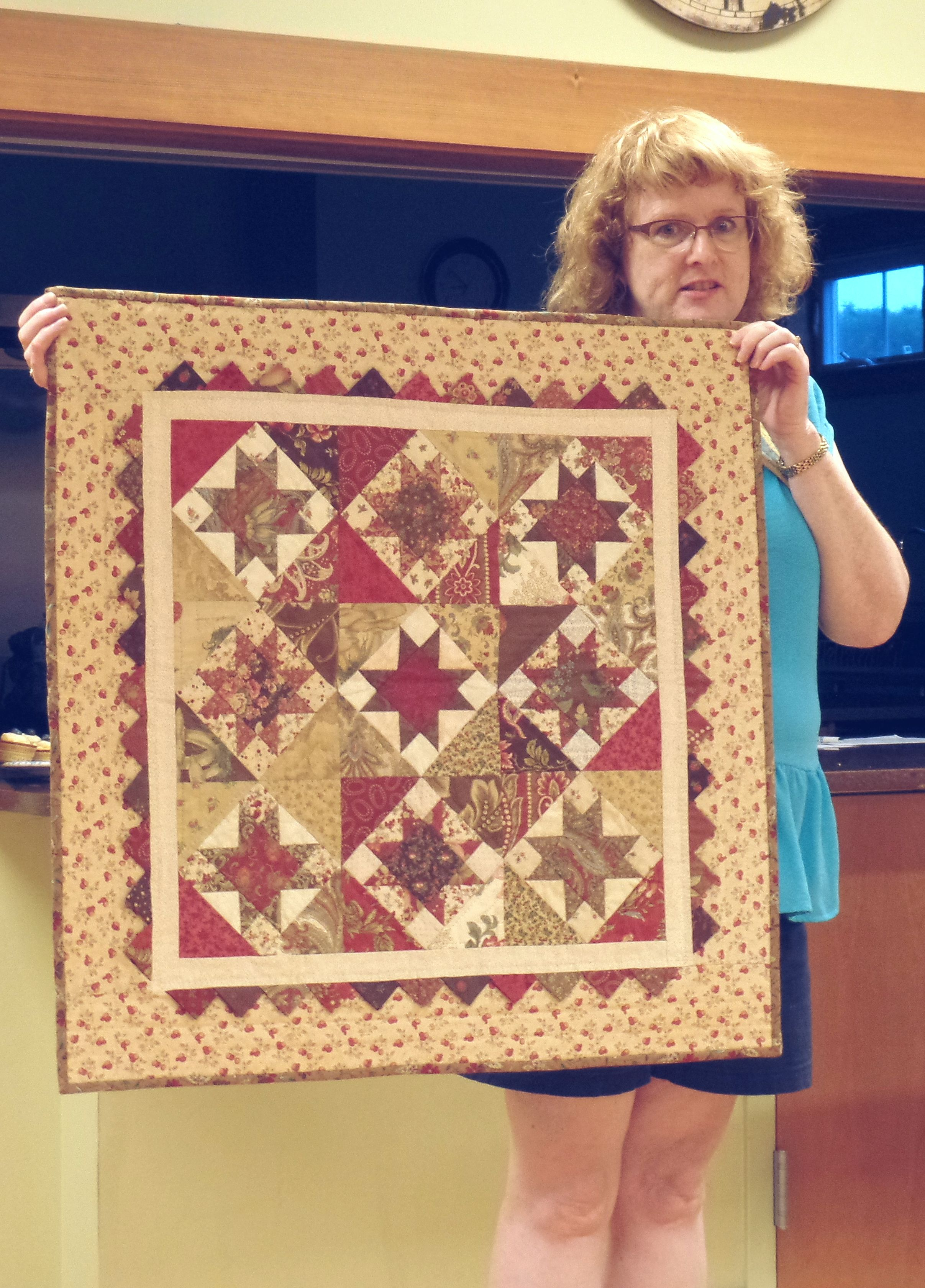 Kim C. W. - Chocolate Stars, Red Ribbon Winner in Vermont Quilt Festival